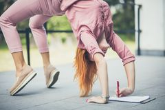 Some things are sometimes different. Business woman working yoga and writing on document stock images
