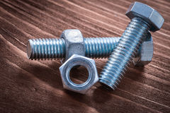 Some threaded stainless bolts and screw nuts on Stock Images