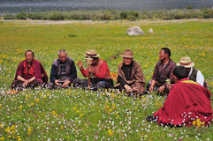 Some Tibetans chatting, sitting on the prairie Stock Photo