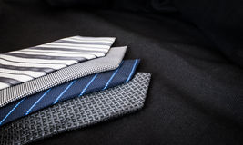Some ties. Of cold colors over black cloth Stock Image