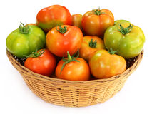 Some tomatoes in a basket Stock Photos