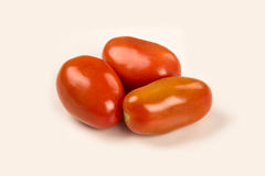 Some tomatoes over a white background. Fresh vegetable royalty free stock image