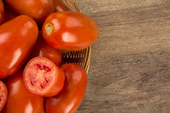 Some tomatoes over a wooden background. Fresh vegetable stock photography