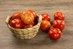 Some tomatoes over a wooden background. Fresh vegetable royalty free stock photo