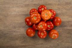Some tomatoes over a wooden background. Fresh vegetable stock photos