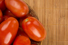 Some tomatoes over a wooden background. Vegetable. Some tomatoes over a wooden background. Fresh vegetable stock photos