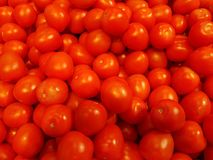Some tomatoes are waiting to be sold. Some tomatoes waiting to be sold stock images