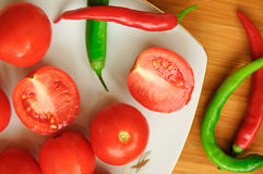 Some tomatos, green and red pepper Royalty Free Stock Photos