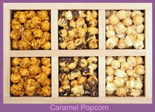 Some tones of caramel popcorn. In wooden box stock photos