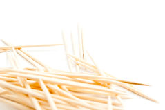 Some toothpicks on white. Heap of wooden toothpicks closeup on white royalty free stock image