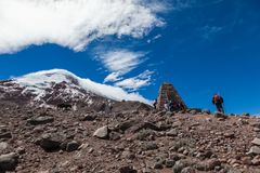 Some tourists climbing the refuge of the Chimborazo volcano. Chimborazo, Ecuador, June 16, 2017: Some tourists climbing the refuge of the Chimborazo volcano on a royalty free stock photo