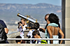 Some tourists come to visit the Basilica of Our Lady of the Guar. D admire the view over Marseille since they Monument Terrace Royalty Free Stock Image