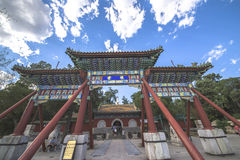Some tourists stay in Beihai park, Beijing. Beijing, China - July 2, 2015:Memorial arch in Beihai park, a royal garden over 800 years Royalty Free Stock Image