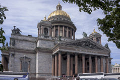 Some tourists visiting the St. Isaac's Cathedral. Saint-Petersburg, Russia - July 4, 2015: Some tourists visiting the St. Isaac's Cathedral, the other looking at Stock Photo