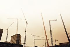 Some tower cranes in the city against the sky. Empty copy space Royalty Free Stock Images