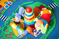 Some toys. Pretty colored toys want to play with the baby royalty free stock photo