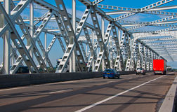 Some traffic over an old steel bridge Stock Images