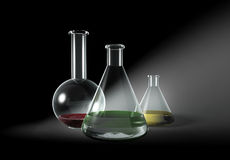 Some transparent glass flasks on grey. Research, laboratory, science, chemical test Stock Photo