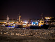 Tug boats and barge at dock winter Royalty Free Stock Images