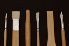 Some type of brushes. On black background Royalty Free Stock Images