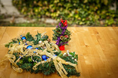 Some typical and decorative Christmas ornaments, on a wooden tab. Le in a patio stock image