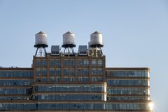 Some typical water tanks on the roof of a building in New York C. Ity stock photo