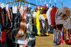 Some used clothes hanging on a rack flea market. Some used clothes hanging on a rack in a flea market stock photo
