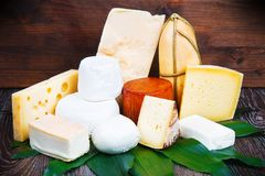 Various types of cheese on white wood. Some Various types of cheese on white wood stock photos