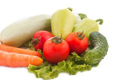 Some vegetables. Squash, carrots, tomato, peppers and cucumber over white Stock Images
