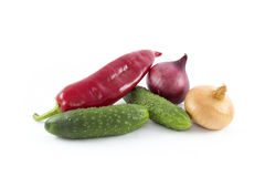 Some vegetables. Some different vegetables - red  pepper, onions and cucumbers Stock Images