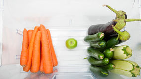 Some vegetables in the fridge. Open fridge filled with fruits and vegetables Royalty Free Stock Photos