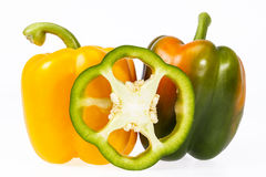 Some vegetables of yellow and green pepper isolated on white background.  stock photos