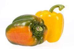 Some vegetables of yellow and green pepper isolated on white background.  stock image