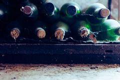 Wine bottles in a wine cellar in an old warehouse royalty free stock photo