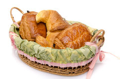 Some viennoiserie in a basket. Isolated on white Stock Images
