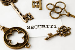 Some vintage keys with word security. Over white royalty free stock photos