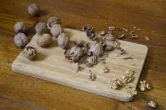Walnuts. Some walnuts split on a wooden table stock images