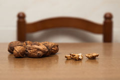 Some walnuts on a table. Vintage Stock Photos