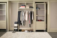 The closet wall. Some wardrobe hanging or put on the shelf in the open closet room royalty free stock photos