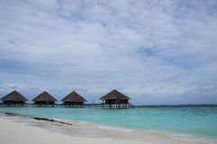 Some water bungalows in the Indian ocean Royalty Free Stock Image