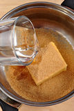Some water with butter and brown sugar. Mix some water with butter and brown sugar royalty free stock images