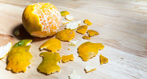 Some were peeling an orange peel. Placed on a wooden table, figure like an earth and map stock photos