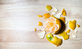 Some were peeling an orange peel. Placed on a wooden table, figure like an earth and map Stock Photography