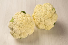 Some white cauliflowers over a wooden surface seen from above. Fresh vegetable Royalty Free Stock Photo