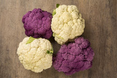 Some white cauliflowers over a wooden surface seen from above. Fresh vegetable Stock Photography