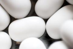 Some white confetti / candies stock photos
