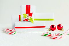 Some white gift boxes with colorful ribbons. Holiday concept, copy space. White paper gift boxes, isolated. Some toys, hand made boxes and bows Royalty Free Stock Photos