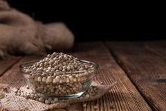 Some white Peppercorns. (close-up shot) on wooden background stock images