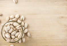 Some whole Pistachios. Selective focus; close-up shot on wooden background stock photo