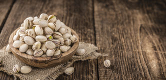 Some whole Pistachios. (selective focus; close-up shot) on wooden background stock images